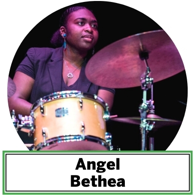 "Born and raised in Washington D.C., Angel Bethea has been seen playing drums and percussion at various venues in the DMV area such as the Brixton, Epicure Cafe, The Kennedy Center, Mr. Henry's, Blues Alley and others. She has been heard all around with groups such as Shannon Gunn & the Bullettes, Terra Firma and the Jeffrey Greenberg Quintet. Some of Bethea's greatest influences consists of great drummers like Terri Lyne Carrington, Kim Thompson, Tony Williams, Elvin Jones, Bryan Carter, Jamison Ross, David Garibaldi and others. She is also passionate about helping non-profit arts organizations like ""The Washington Jazz Arts Institute"" located in D.C. as a performer and mentor to the young students in training."